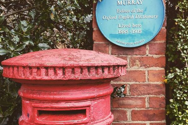 Letter box outside Murray's home with blue plaque