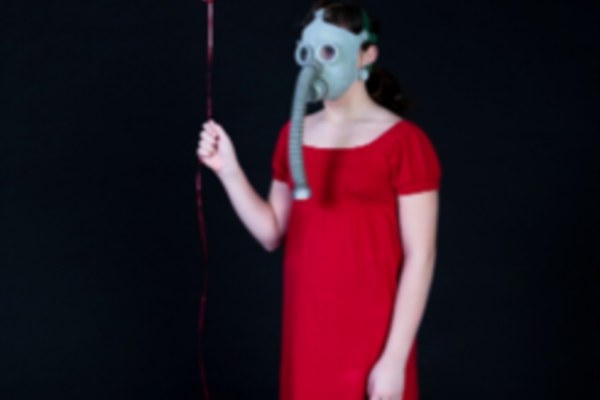 contagion cabaret woman in red dress with gas mask and balloon
