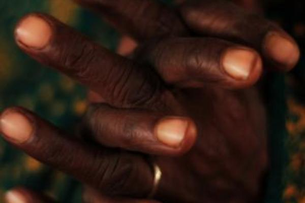 close up of hands with fingers interlocked