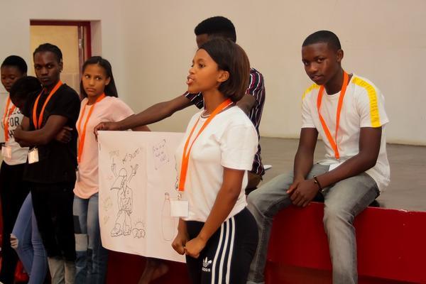 Students giving presentation at Accelerate Hub workshop