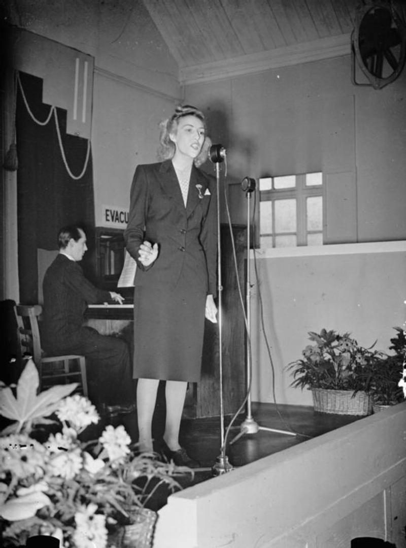 Vera Lynn singing at a munitions factory UK 1941