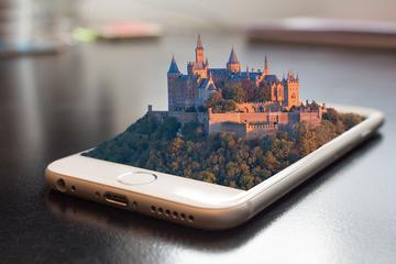 Imaginary city growing out of a smartphone