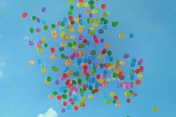 balloons floating into the sky